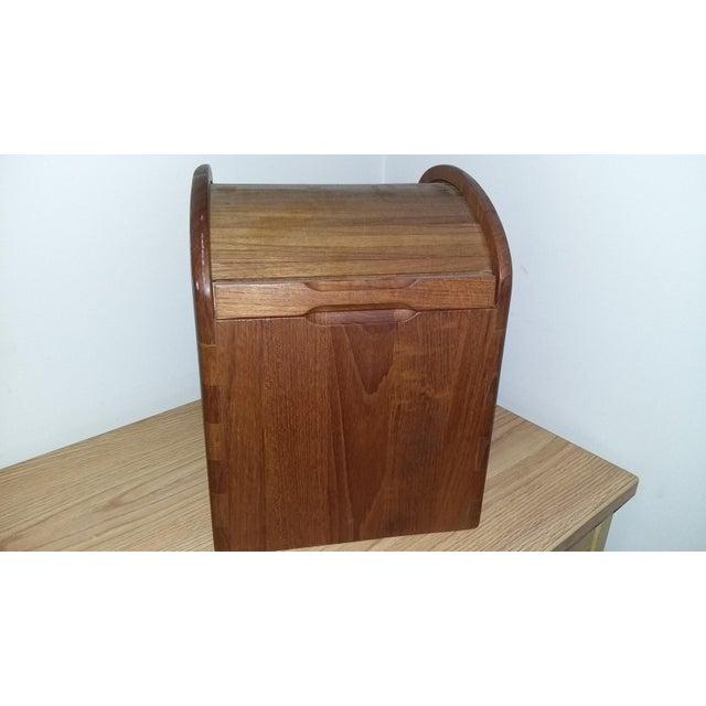 Vintage Danish modern teak wood ice bucket by Kalmar designs. This piece has a tambor door that opens and closes easily....