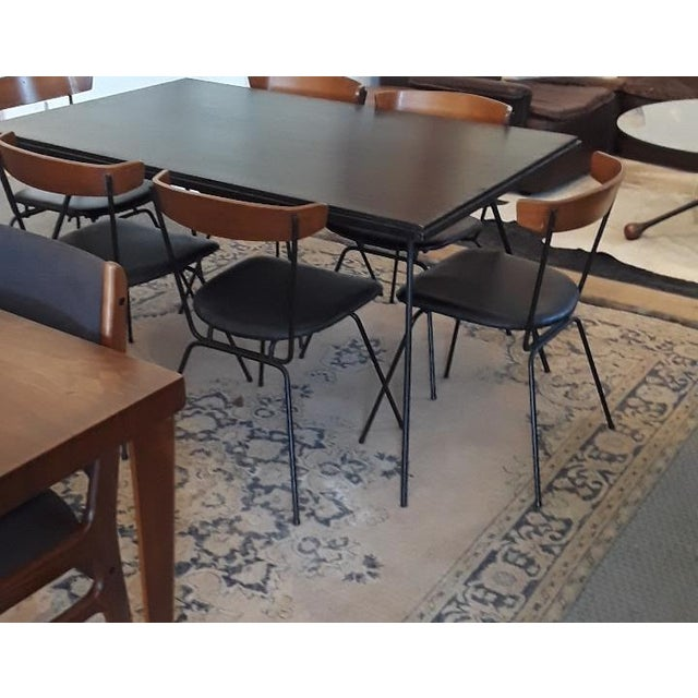 Big Daddy's Antiques presents a dining set designed by Clifford Pascoe in 1951. The set includes six chairs and a table....
