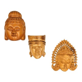 Collection of Three Carved Wood Buddha Head Wall Masks | Japanese & Balinese Hanging Wood Buddha Face Masks For Sale