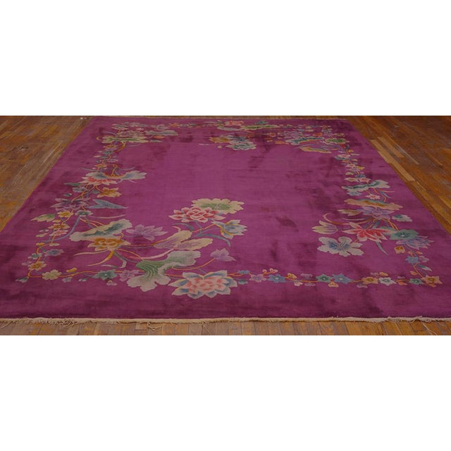 "This is a Chinese art wool rug from China 1920. The size is 8'6""x11'4"". The colors are purple, pink, blue, green, brown,..."