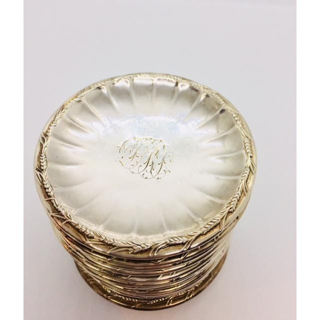 Set of 12 Monogrammed Sterling Butter Pats by Gorham. Circa late 19th century. Monogram is quite fancy and looks like a...