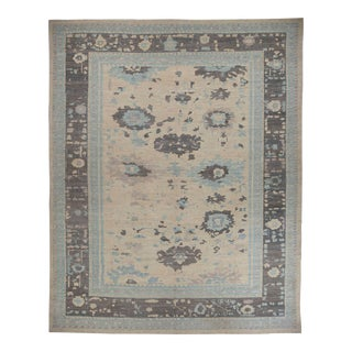 Persian Oushak Style Rug With Blue & Gray Floral Details on Beige Centerfield For Sale