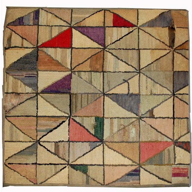 Handmade antique square American hooked rug in good condition. The rug has been made in geometric design. Very unusual...