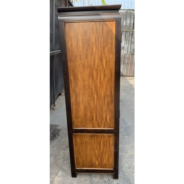 Striking 70's burl wood multi-compartment armoire by Raymond Sobota for Century Furniture's Chin Hua Collection. This...