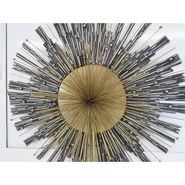 Very large brass and aluminum shooting star / starburst form wall handing by Curtis Jere. This is one of his premium works...
