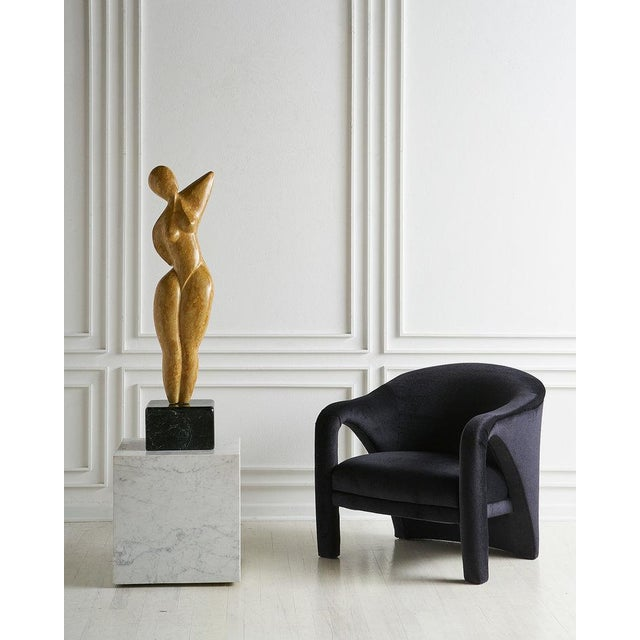 A Vladimir Kagan style chair with an elegant curvature to the arms and back. Newly reupholstered in an Italian black...