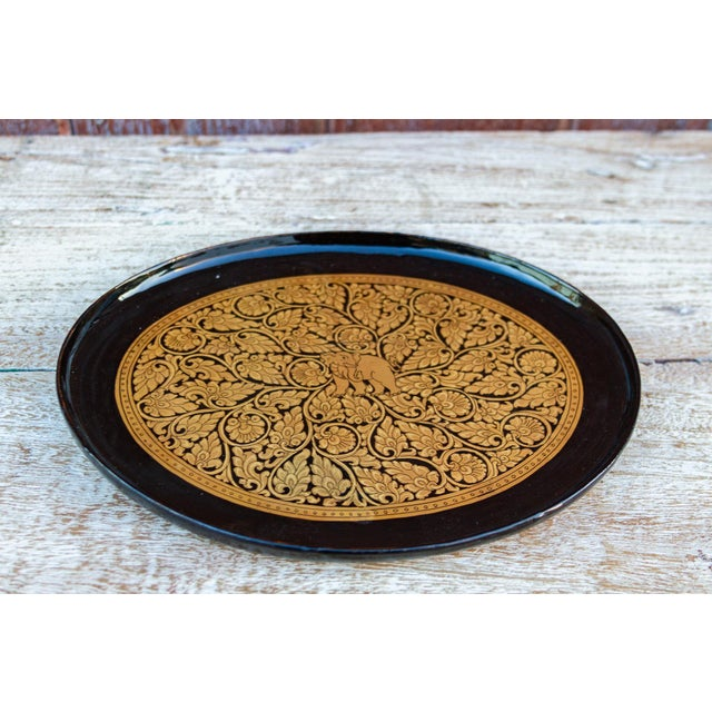 This lovely decorative paper mache tray, all hand-painted in a black and gold embellished finish with beautiful detail and...