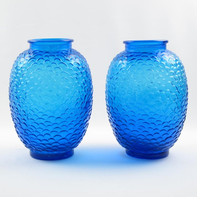 Stunning Pierre D'Avesn pair of electric blue glass vases. Molded pressed glass vases in shouldered form with cast and...