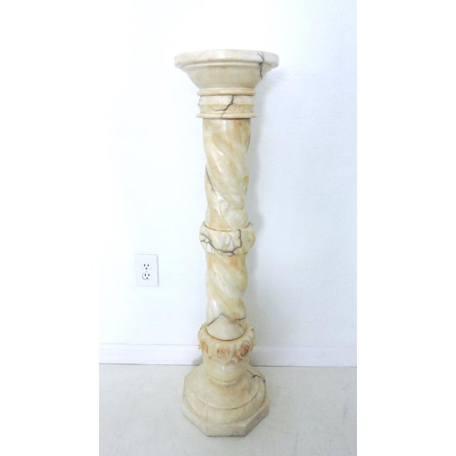 Two piece vintage alabaster pedestal or pillar/stand with attractive gray veining. Hand carved floral decorative bands on...