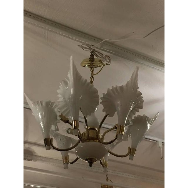 Mid-Century Modern Murano chandelier with six handblown glass white flower petals. Having a brass and white glass frame.