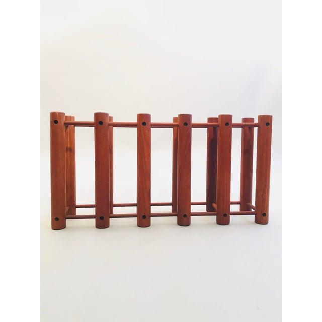 Teak Wine Rack by Richard Nissen. Can house up to 5 bottles of wine.