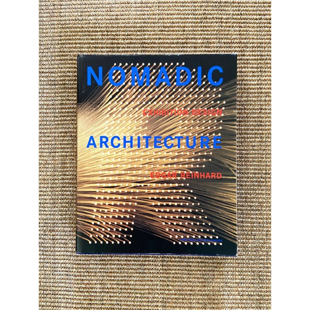 This English edition hardcover book demonstrates Edgar Reinhard's exhibition design architecture. The cover is blue and...