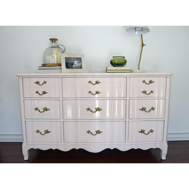 Beautiful Huntley antique dresser refinished in gloss lacquered pink. Original polished handles. Use it as a dresser,...