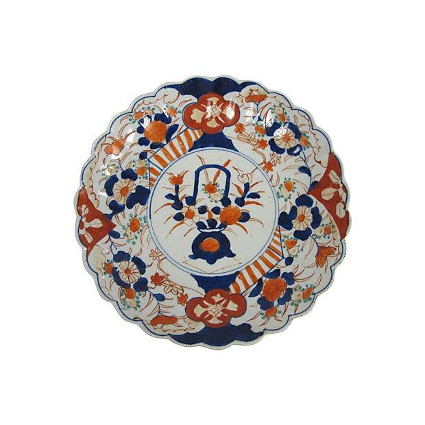 Antique Japanese porcelain Imari charger. Hand-painted, made during the Meiji period, circa 1890. No maker's mark. Light...