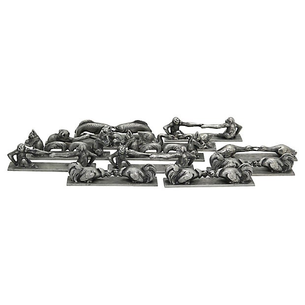 Set of twelve French Art Deco knife rests. In original storage box. Very nicely detailed with a variety of animals....