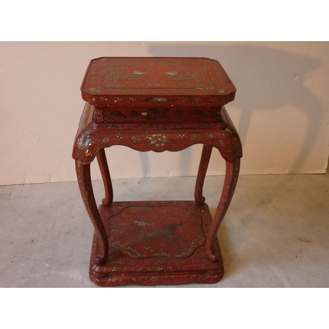 19th Century Chinese vermilion red laquer stand with nacre shell inlay work.