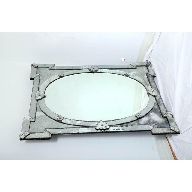 Exquisite large scale Venetian mirror with beveled edges and beautiful hand etched designs throughout. The mirror features...