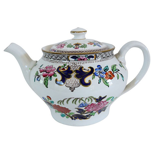 Antique Minton's floral patterned teapot. Maker's mark on underside. Light wear.