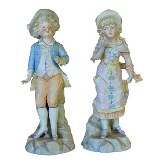 German Bisque Porcelain Figurines of a Boy and a Girl Statue - a Pair For Sale