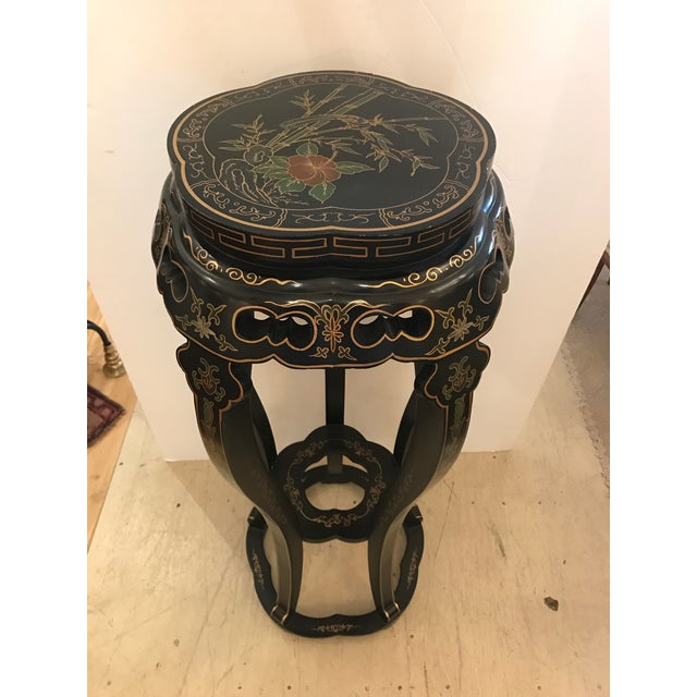 Attractive chinoiserie stand for plant or sculpture. Background is black with red and green embellishment. Top diameter is...