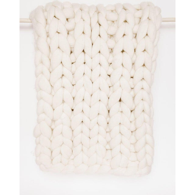 Looks like a blanket, feels like a cloud. Handcrafted in Peru and made from thick unspun wool, this extra chunky throw is...