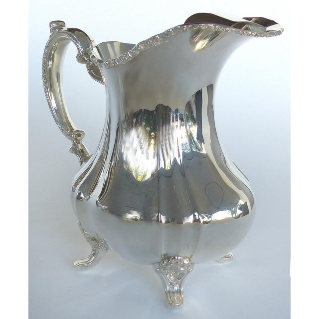 Offered for sale is a Gorham electroplated nickel silver footed water pitcher. The pitcher has an ice lip and is marked...