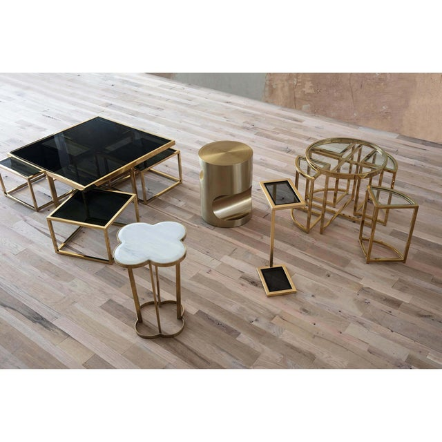 Full of charm and modern appeal, this clover-shaped steel side table combines a natural brass finish and creamy white...
