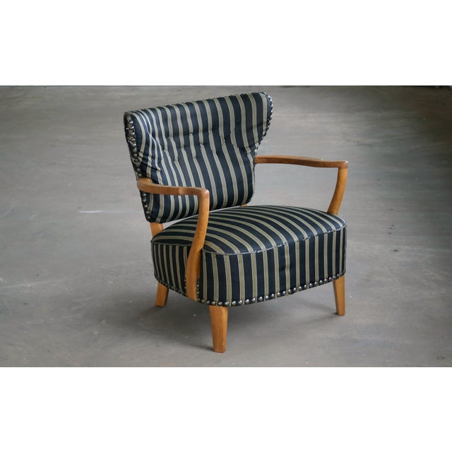 Fantastic 1940s Otto Schulz style lounge chair made by unknown Danish master carpenter sometime in the 1930s or 1940s. The...