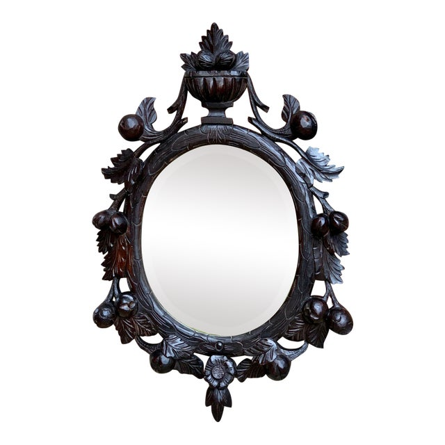 19th Century Antique English Black Forest Style Carved Dark Oak Oval Wall Mirror For Sale