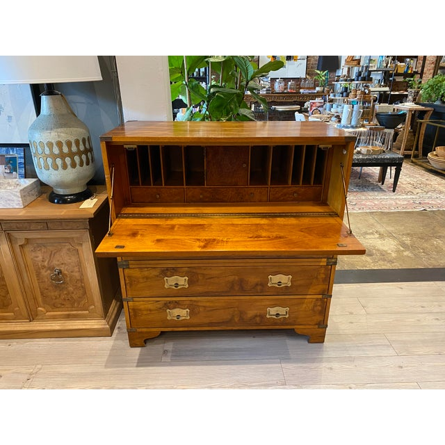 MCM Campaign-style drop down secretary chest. With compartments and smaller drawers for desk accessories. The last three...