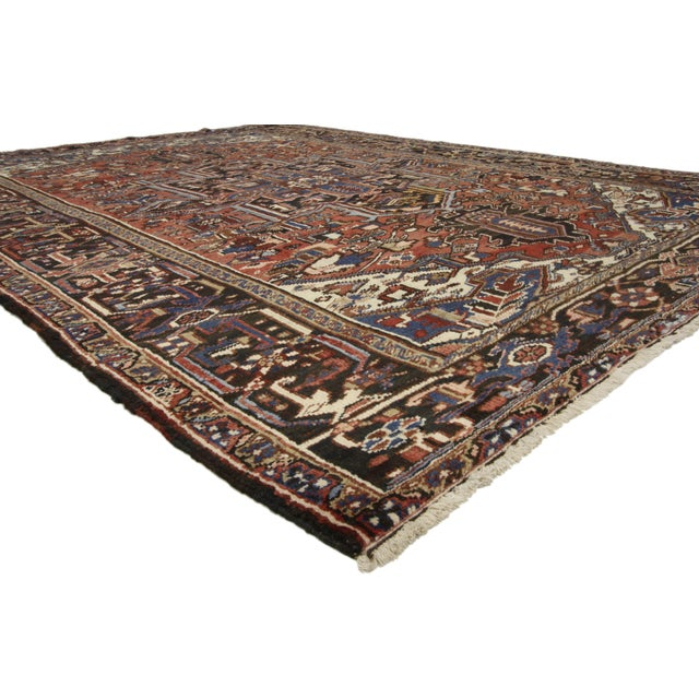 Vintage Persian Heriz Rug with Mid-Century Modern Downton Abbey Style. Traditional and regal with brilliant color, this...