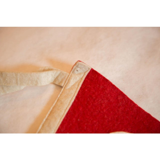 :: Vintage felt flag pennant from Northfield, Massachusetts. Simple capitalized lettering atop a solid red background. On...