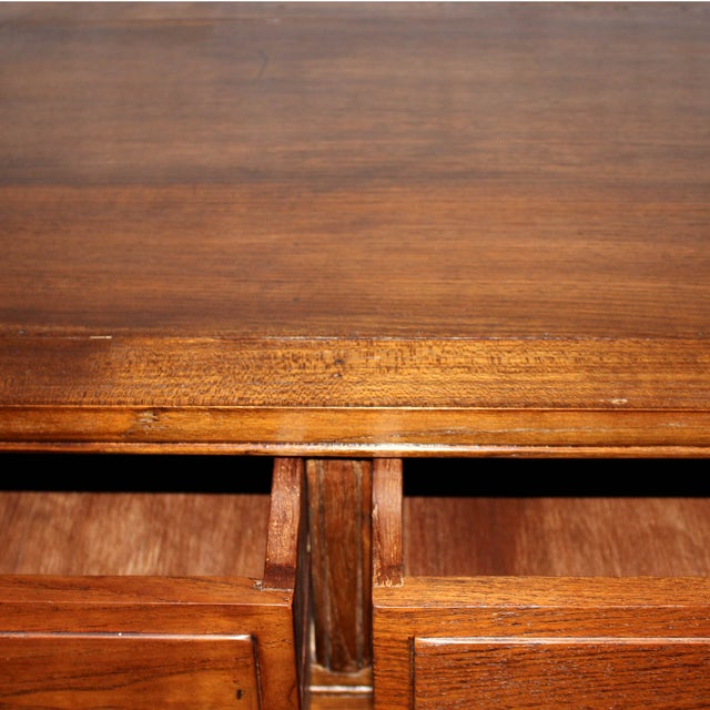 Teak console table with drawers and carved apron can be placed in an entryway, living or dining room with lamps and...