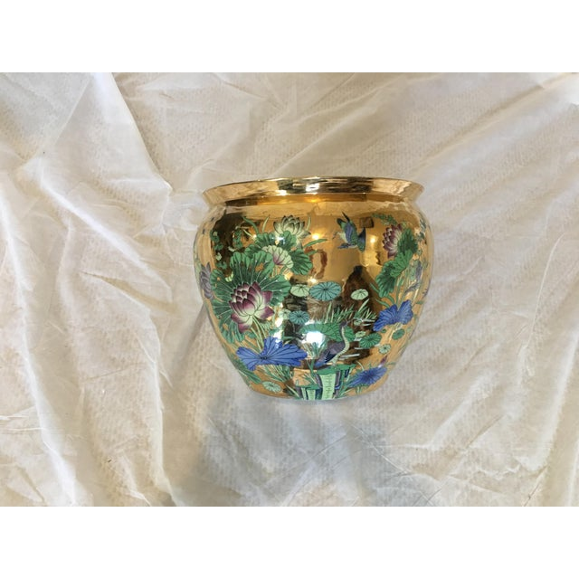 Beautifully Hand painted porcelain pot with gold leaf, inside also painted . The painting on outside is raised with very...