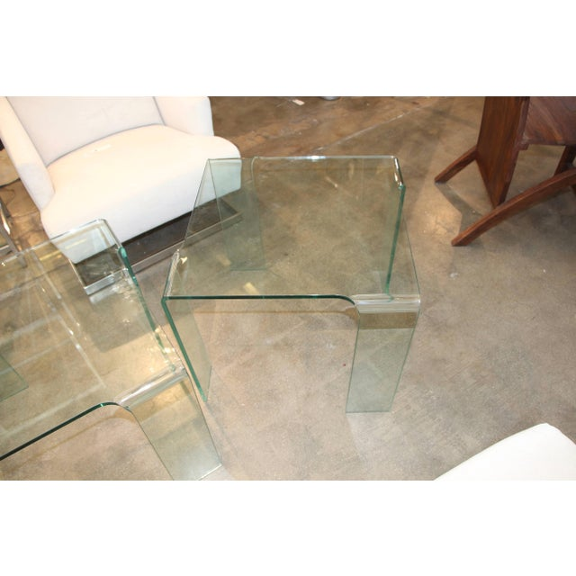 An elegant pair of Italian glass end tables attributable to Fiam likely from the 1980s. In good age appropriate condition,...