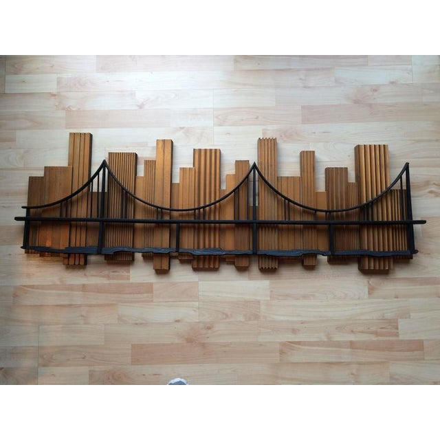 1969 Skyscraper bridge sculpture. Signed and dated. Dramatic black over metallic gold. The perfect backdrop for a Mid-...