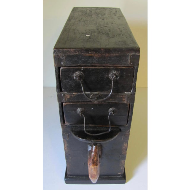 Interesting Chinese tool box used by a metalsmith. Primitive construction , 2 drawers.