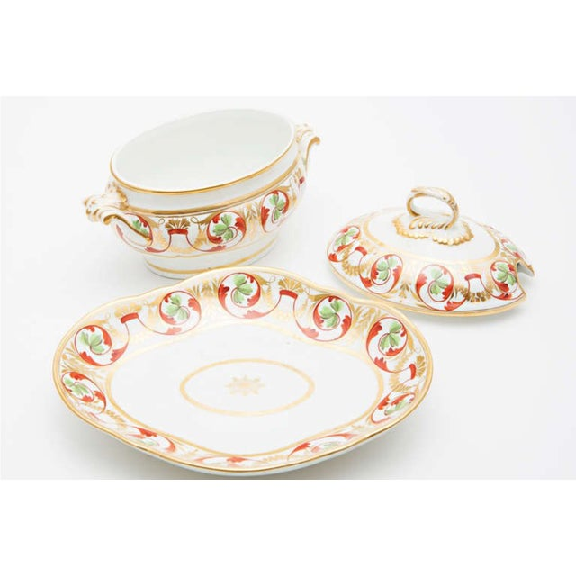 "Set of four pieces including two matching bowls (11"" x 8.5"") one scalloped dish (9.5"" x 12"") and tureen with underplate..."