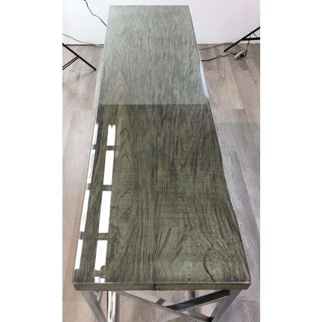 Stylish industrial modern reclaimed teak wood and stainless steel console table, glass top, showroom floor sample