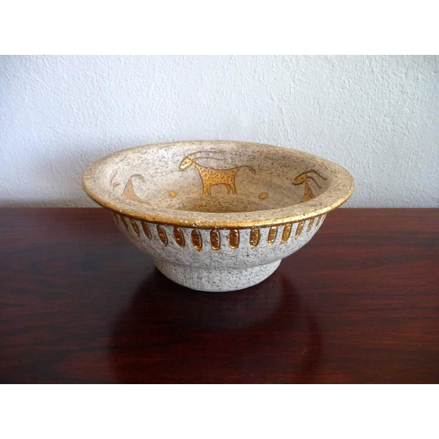 This vintage bowl is from Italian company Bitossi. It has an unusual and rare cave painting motif and a lovely allover...
