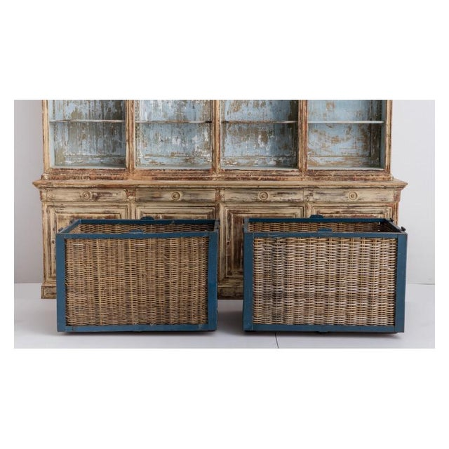 Pair of large, industrial French wicker baskets from a wool mill painted steel frames featuring original blue paint. There...