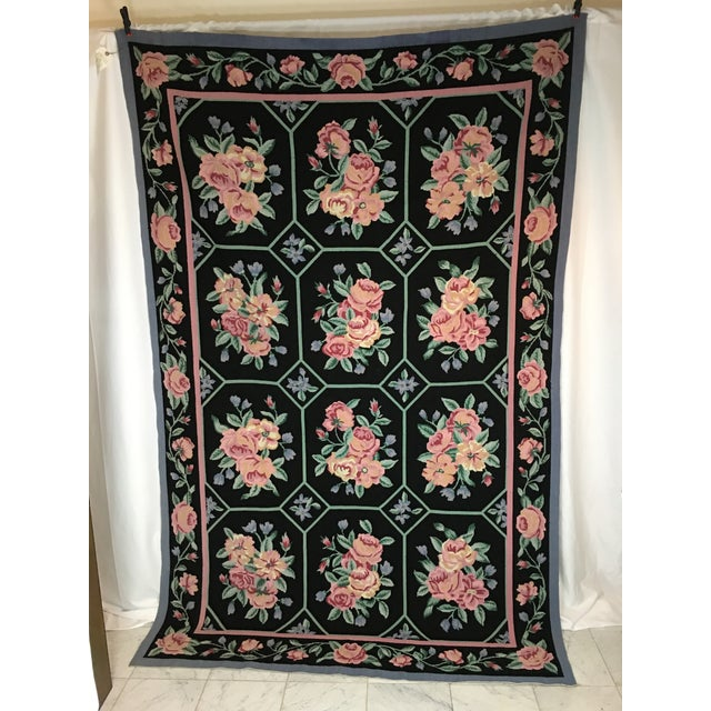 """Colorful multi colored floral Needlepoint Rug measuring 104"""" x 67"""". In colors of black , blues , greens, pink , tan and..."""