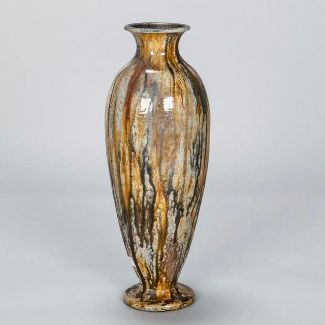 Hand glazed pottery vase by renowned Belgian ceramic artist Roger Guerin, circa 1930s. Drip wash glaze in tones of ochre...
