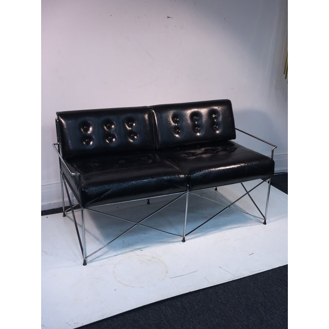 Great looking tubular chrome loveseat in a cross stretcher form design. Made in the 1970s. Upholstered with two backrests...