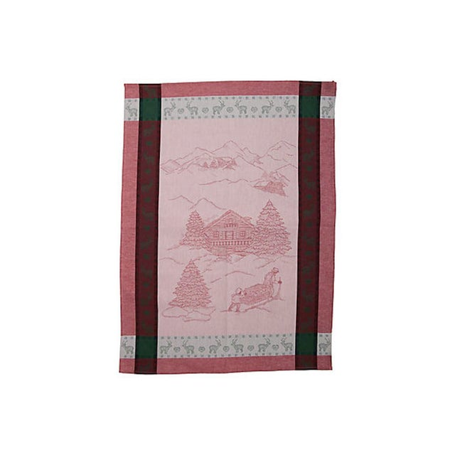 French green and red cotton dish or tea towel with winter/holiday chalet scene in center surrounded by a deer and heart...