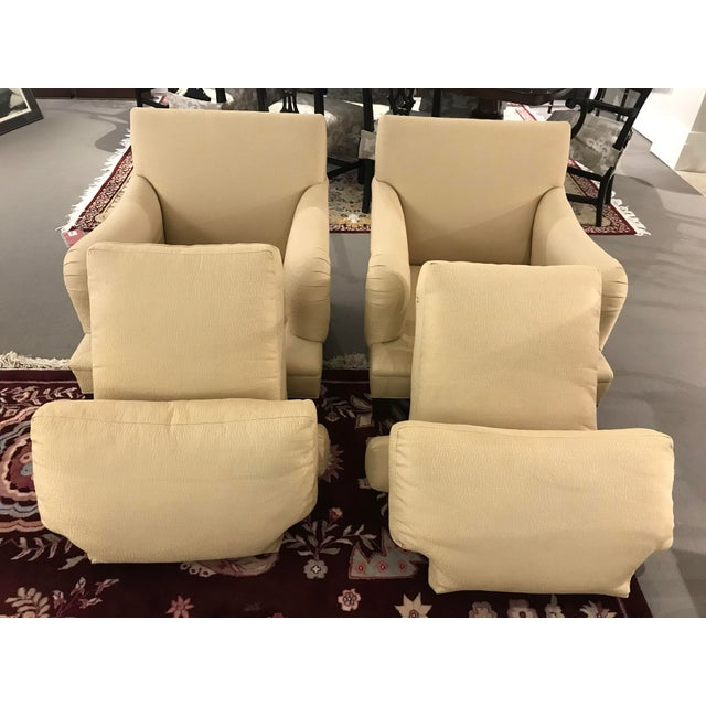 Pair of Baker Simmons chairs with exposed legs and detachable cushions. Original Baker fabric, barely used. No rips,...