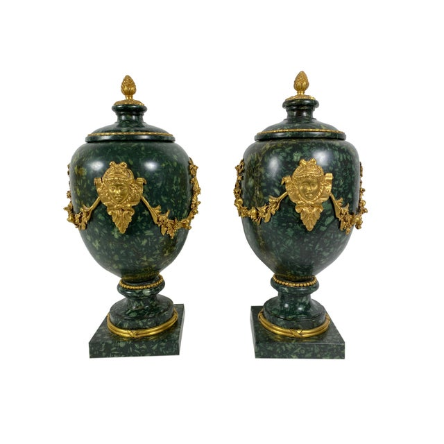 Pair of green Porphyry stone vases. Porphyry stone from the 18th century or earlier with 19th century bronze dore mounts,...