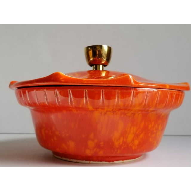 Striking California Pottery orange and burnt orange glazed ceramic casserole dish from the 1960's. Great pattern and Mid-...
