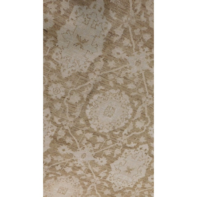 This Afghan rug features hand spun wool in neutral tones. 8' x 10'