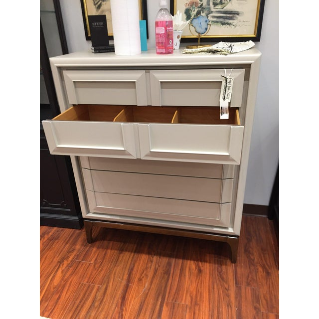 Vintage, tall tan dresser. Modern finish and classic look!
